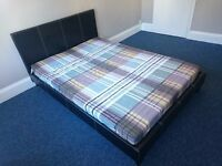 Double bed, black leather-look frame and mattress, 6 months old