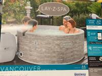 Hardly used Lay-Z-Spa Vancouver AirJet Plus 5 seater hot tub With App Control 2021 Model