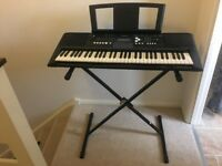 Yamaha PSR E333 full size electric keyboard with stand.