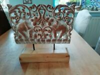 Lovely carved wooden elephant frieze on metal legs and wooden plinth