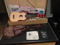 Ukulele plus carry bag, tuning instructions, and spare strings