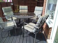 Metal table and 4 chairs with cushions