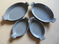 CAST IRON OVAL GRATIN DISHES - 2 Large, 2 Small. EXCELLENT CONDITION SUITABLE FOR OVEN TO TABLE USE.