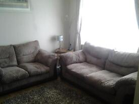 2 brown, corded sofas for sale.
