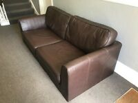 THREE SEATER BROWN GENUINE LEATHER SOFA AND MATCHING ARMCHAIR (WITH OR WITHOUT WOODEN LEGS)