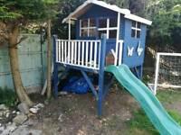 Raised playhouse with slide