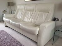 Off -white leather suite with sofa, chair and storage stool.