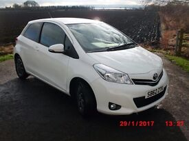 Good condition White Toyota Yaris Edition VVT-1, Alloy wheels, Rear tinted windows.