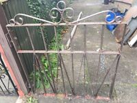 Pair of wrought iron gates and fixings