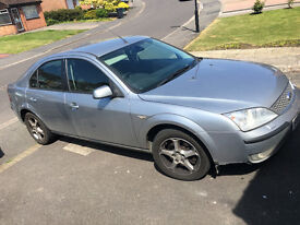 Silver 07 plate Ford Mondeo.