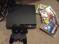 PS3 console 2x controllers & 4 games