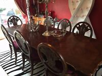 Beautiful large antique style dining table with 8 chairs. Few age marks but overall good condition.
