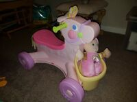 Musical ride on pony with doll