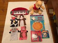 Bundle of toys Melissa and Doug puppets, keyboard, Winnie the Pooh and books