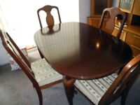 Dark Wood Dining Table and Four chairs