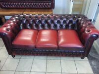 Large three setter ox blood leather chesterfield.