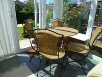 Wicker and Iron conservatory table and 4 chairs