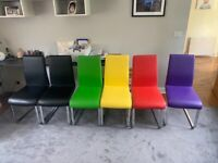Glass Dining Table and Coloured Chairs