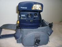 Polaroid camera with case,