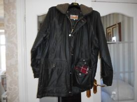 Mens wax jacket with hat.