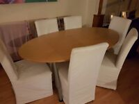 Dining table and 6 chairs with covers