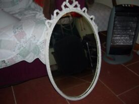 ORNATE OVAL MIRROR, with ribbon effect around the top. Very pretty. see photos