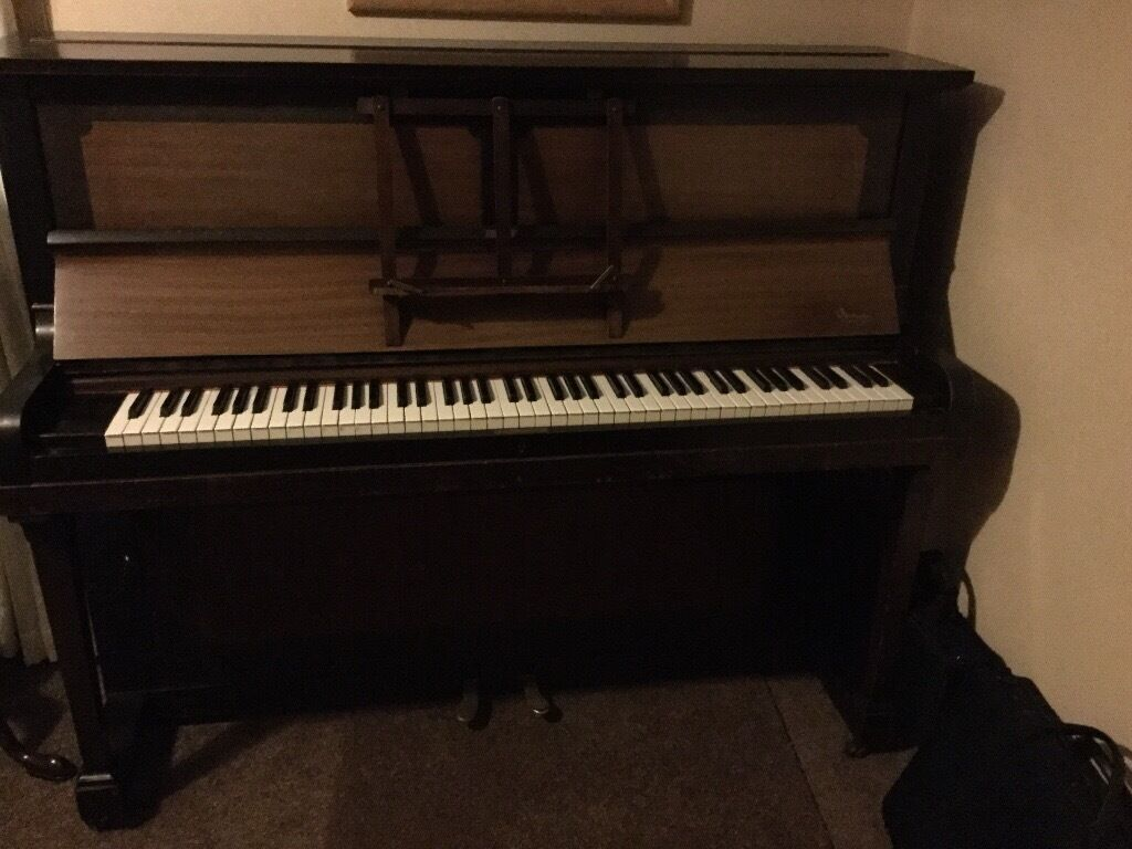 Piano in beautiful polished case.