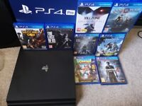 PS4 Pro & 8 Games (incl. God of War, Horizon, Uncharted 4, Crash B) / Immaculate with Box