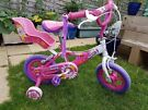 """Sonic Daisy 12"""" girls bike with stabilisers and doll seat, hardly used, VGC. Starting bike 2yr +"""