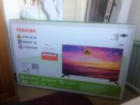 TOSHIBA 49 INCH SMART 4K ULTRA HD LED BACKLIGHT BREND NEW IN BOX TV.