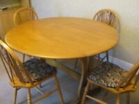 """Old Charm solid oak 48"""" round drop leaf table and 4 Wood Bros. Old Charm chairs"""