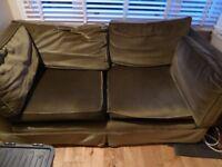 Two seater sofa in green velvet
