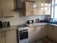 Single room in shared clean modern house . Available now