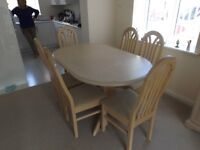 Dining furniture - limed oak table and six chairs. along with matching display unit and bookcase.