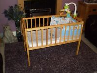 Baby crib with mattress, bedding and mobile