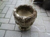 an old pot for plants. it measures height 27 cms and diameter 23 cms