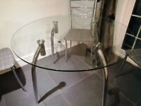 Glass circular table and four chairs