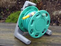 HOZELOCK HOSEPIPE 70FT IN LENGTH COMPLETE WITH SPRAY NOZZLE .