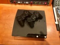 PS3 120gb Slim + 2 controllers + 11 games