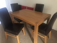 NEW solid oak table and 4 chairs