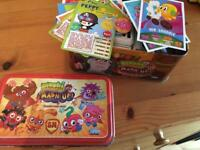 Moshi Monsters tin, filled with cards and some badges