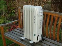 BRAND NEW OIL FILLED ELECTRIC RADIATOR