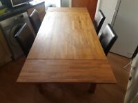 Solid wood Table and chairs sits 8 ,buyer collects £150 o.n.o vgc W 90cm, L 150 ext to 210cm
