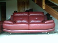 3 and 2 seater red leather sofas , 1 month old , from harveys .