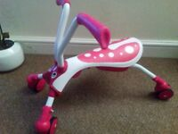Unused pink Mookie Scramble Bug bike/scooter excellent condition.