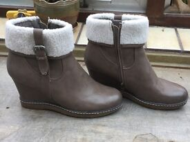 Ankle boots with a warm fur sleeve size 6 with a wedge heel. Taupe in colour. Excellent condition.
