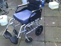 FOLDING WHEELCHAIR IN EXCELLENT CON IS LIGHTWEIGHT HAS CUSHION AND 18 INCH SEAT CAN DELIVER
