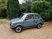 a 1985 Fiat 126 brown, blue, 18.806 low mileage, full MOT, Serviced, 2 door, Overall MINT