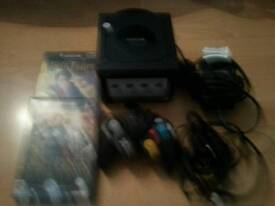 NINTENDO GAME CUBE WITH LEADS CONTROLLA AND GAMES