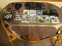 Xbox 360, 4 x wireless controlers, sky lander boxe and much more £150